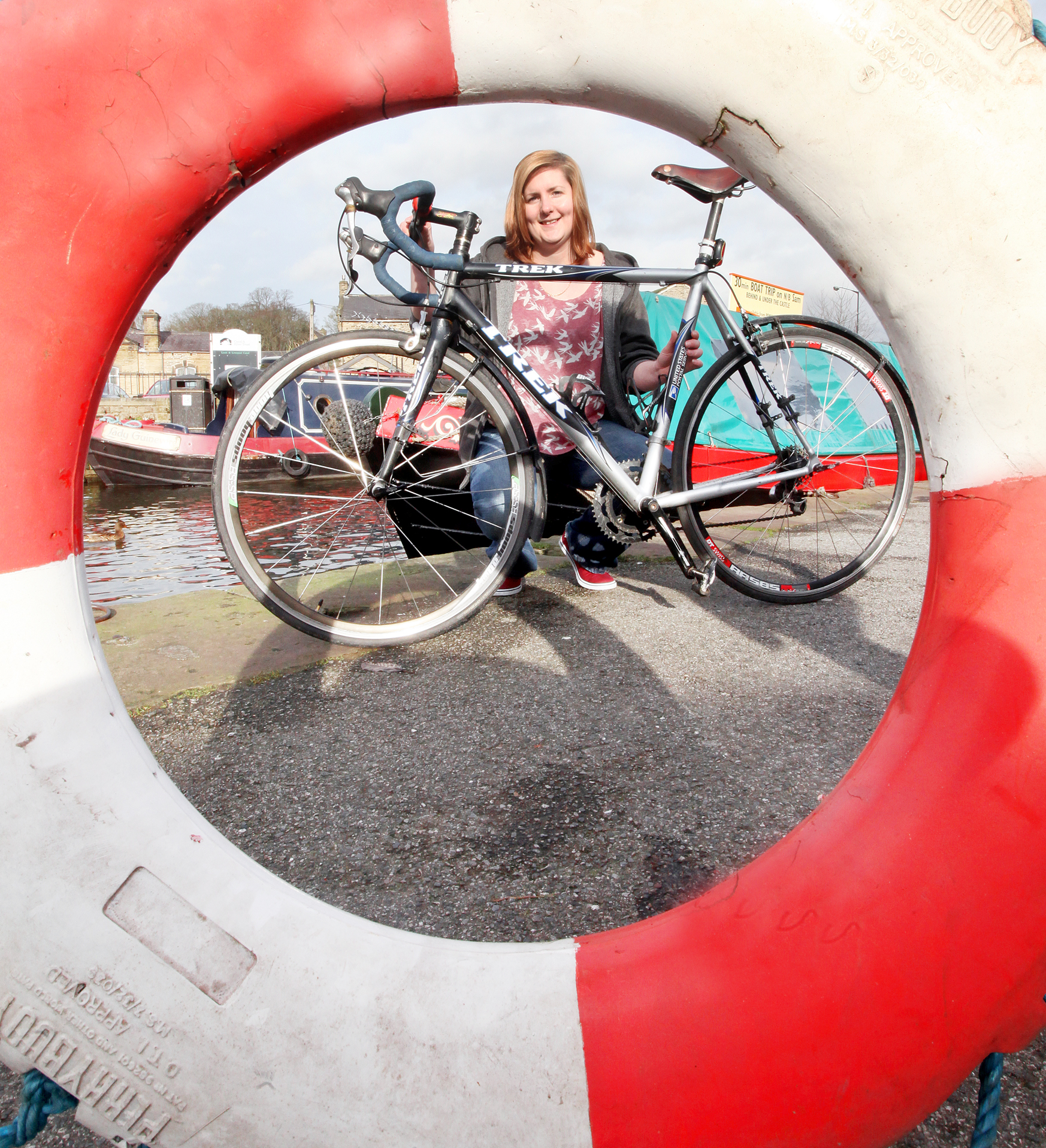 Zoe Clarke, from Pennine Cruises, framed by a lifebelt