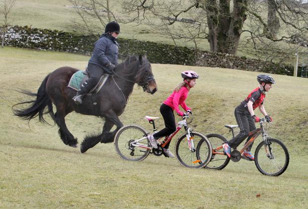 Headteacher Gill Woods and pupils Katie Gudgeon and Ryan Maudsley prepare for last year's ride