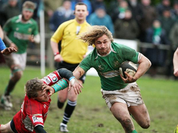 Craven Herald: ASSIST: Aaron Myers hands off an opponent before Joe Donkin crossed for Dale's try