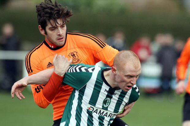 Craven Herald: Steeton's Graham Holmes resists a challenge from Oxenhope's Scott Nelson