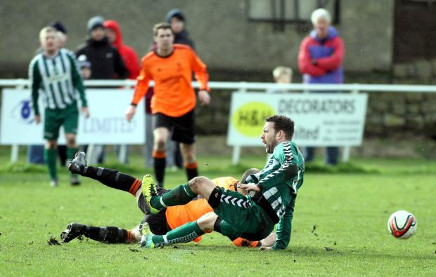 Craven Herald: Steeton's Jamie Longley, pictured in the cup clash with Oxenhope, faces a two-month lay-off with a medial ligament injury