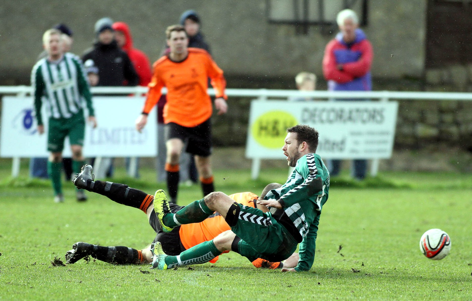 Steeton's Jamie Longley, pictured in the cup clash with Oxenhope, faces a two-month lay-off with a medial ligament injury