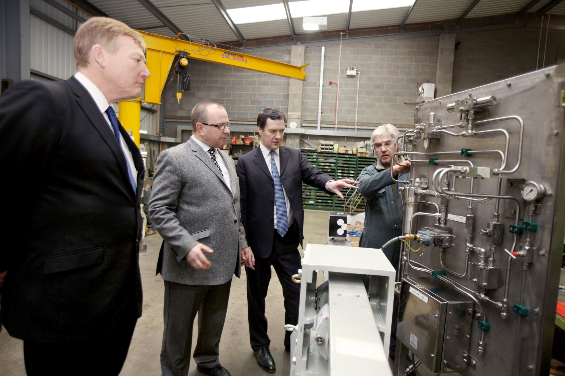 Chancellor George Osborne tours Advanced Actuators with MP Kris Hopkins (left) and company director Chris Woodhead