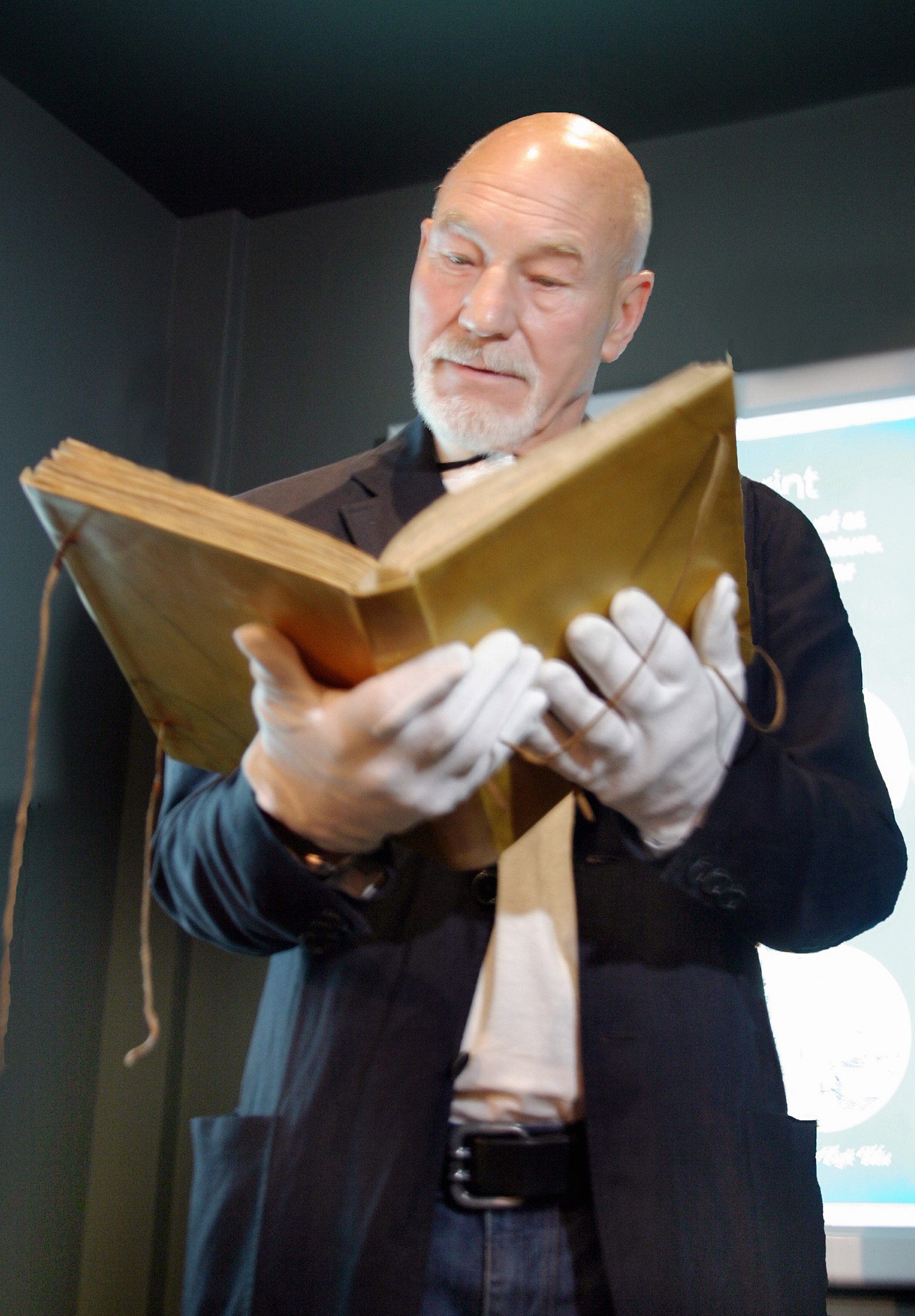 Actor Sir Patrick Stewart studies the Shakespeare First Folio which was gifted to Skipton