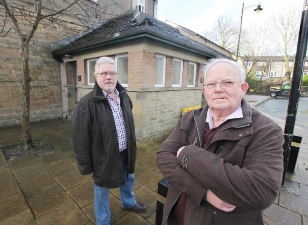 Craven Herald: Mike Goulthorp and Councillor Morris Horsfield outside the bus station toilets