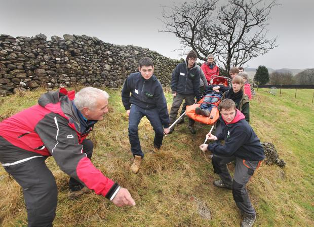 Craven Herald: Apprentices tend to an injured walker
