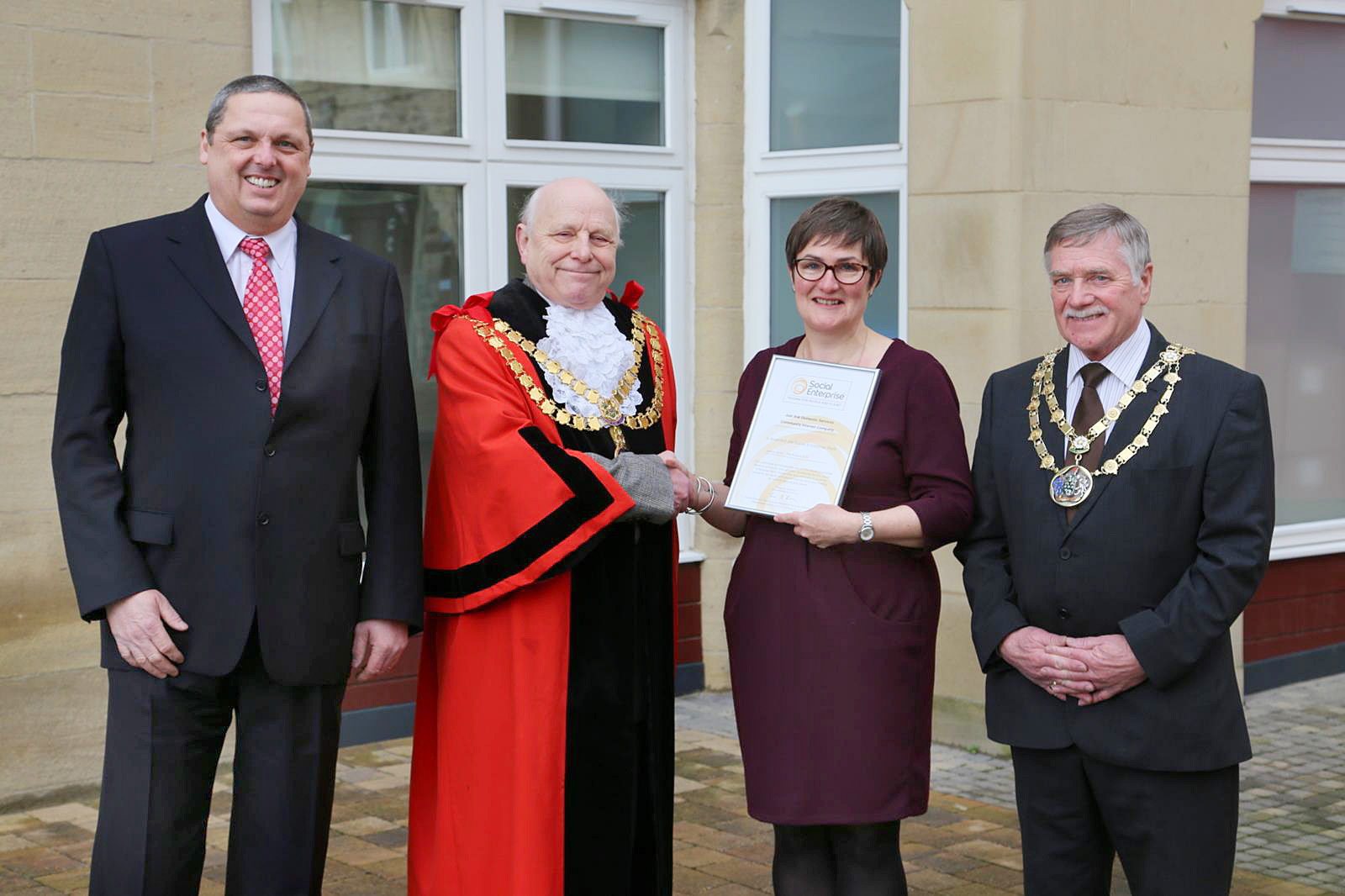 Steve and Sarah Hulbert receive their Social Enterprise Mark from  mayor John Kerwin-Davey and council chief Donny Whaites