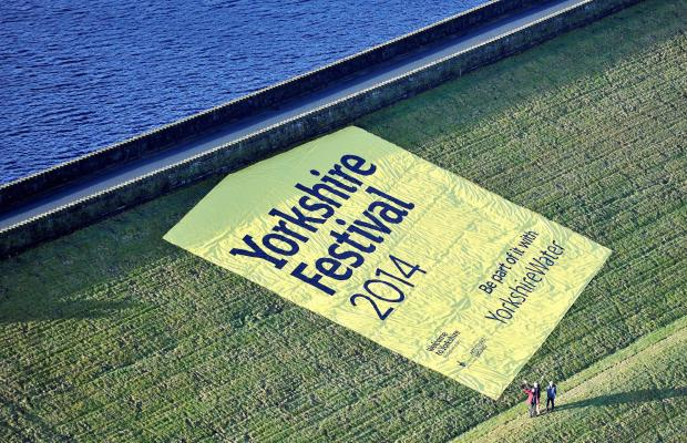 The banner announcing the Yorkshire Festival on the side of a Yorkshire Water dam