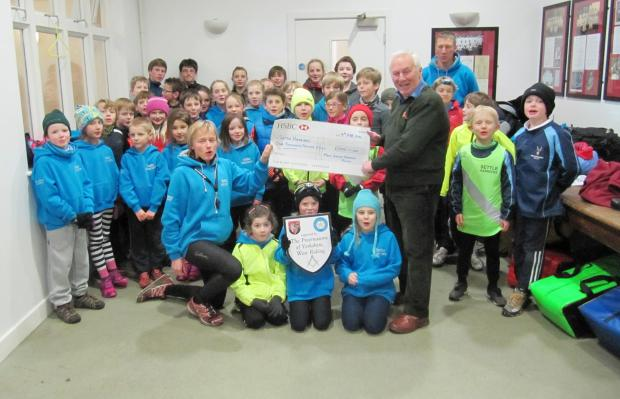 The cheque is handed over to Settle Harriers