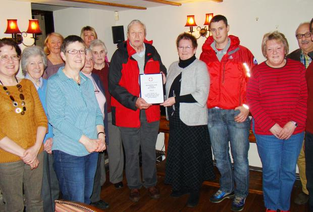 Chris Baker is pictured presenting a UWFRA certificate to Jill Holden, of the Devonshire Arms quiz team