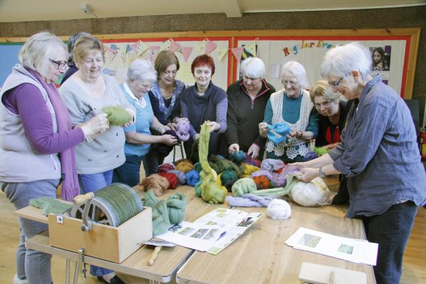 Members of the Embroiderers' Guilds in Skipton and Grassington selecting wool tops to make the hanging with Jacky Lunn (centre)
