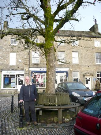 Grassington Parish Council chairman Michaeol Rooze in front of the landmark sycamore tree which is to be felled