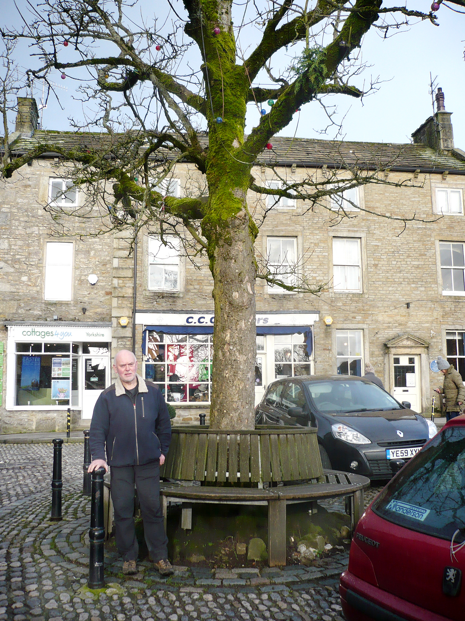 Grassington Parish Council chairman Michaeol Rooze in front of the landmark sycamore tree which i