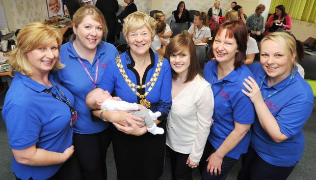 Craven Herald: From left, midwives Liz Robinson and Sue Banks; Lesley Page, president of the Royal College of Midwives with baby Lana and mum Frances Handbury; and midwives Lindsay Hobbs and Karen Illingworth