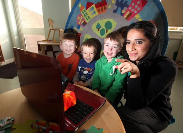 Brougham Street Nursery teacher Raheela Khan, with Elliot Moore, Oliver Johnston and Gil Townsley after the positive Ofsted report