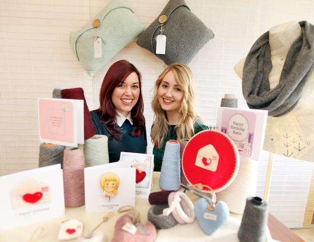 Tania Ashby and Michelle Harrison with some of the knitwear and stationery gifts