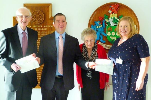Former chairman of Craven District Councillor Chris Harbron, second left, presents cheques to (from left) Allan Cawood (Parkinson's UK, Skipton Branch),  Margaret Whiteside (Parkinson's UK) and Bronagh Daly (Airedale General Hospital)