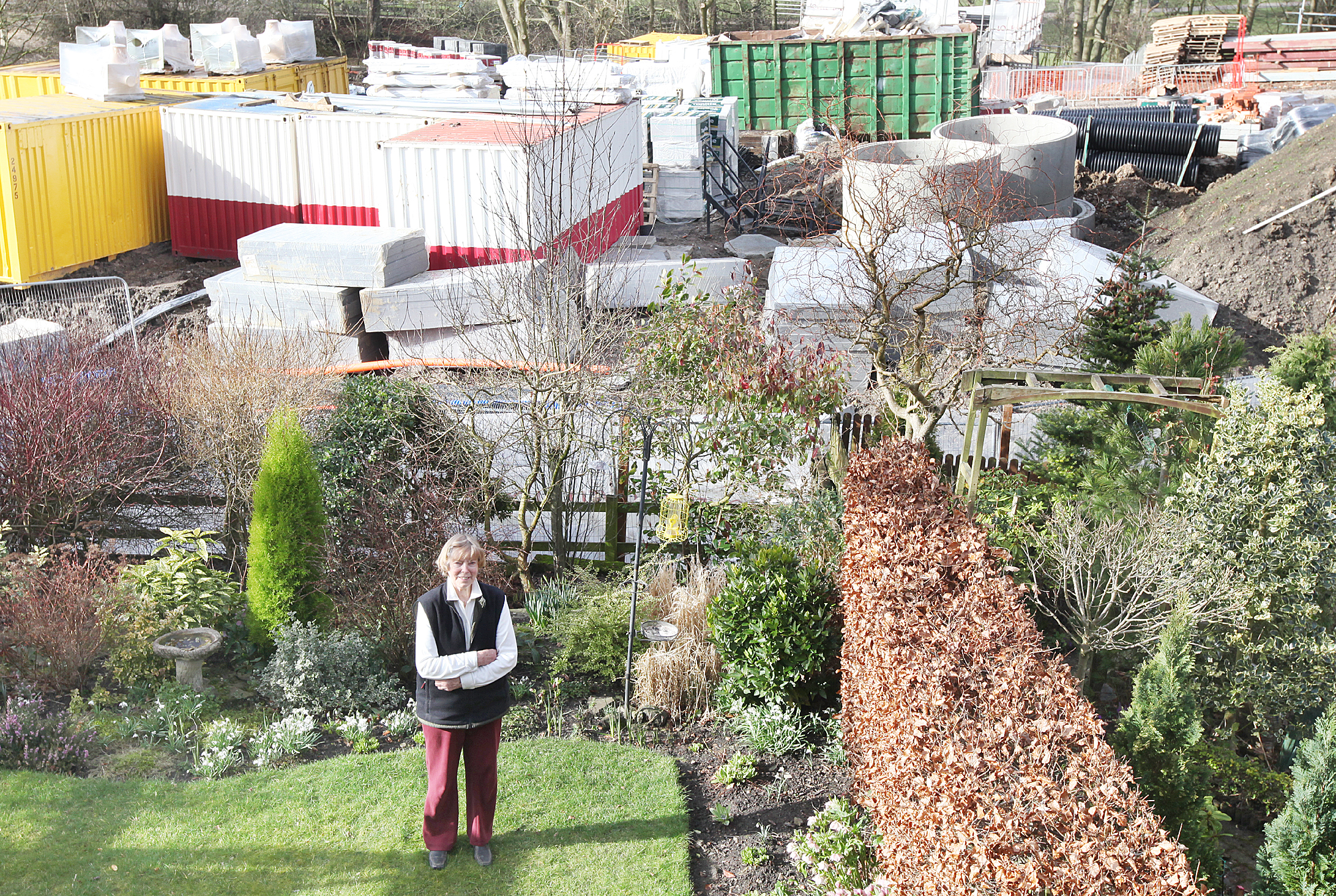Claire Watters pictured with the development at the end of her garden