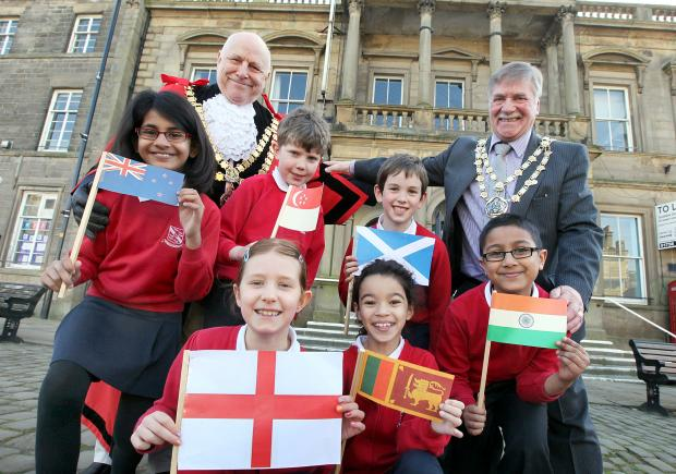 St Stephen's School pupils Darcey Burrell, Chelsie Vas, Cole Bateson, Gabriel Benny, Harry Chisnall and Isabella Chandler join mayor John Kerwin-Davey and Craven District Council chairman Donny Whaites at Skipton Town Hall