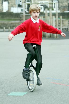 Jacob Eakin on his unicycle