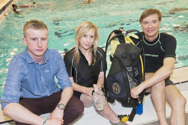 Engineering student Lewis Jones, left, with divers Sue Wright and Nigel Ealand.