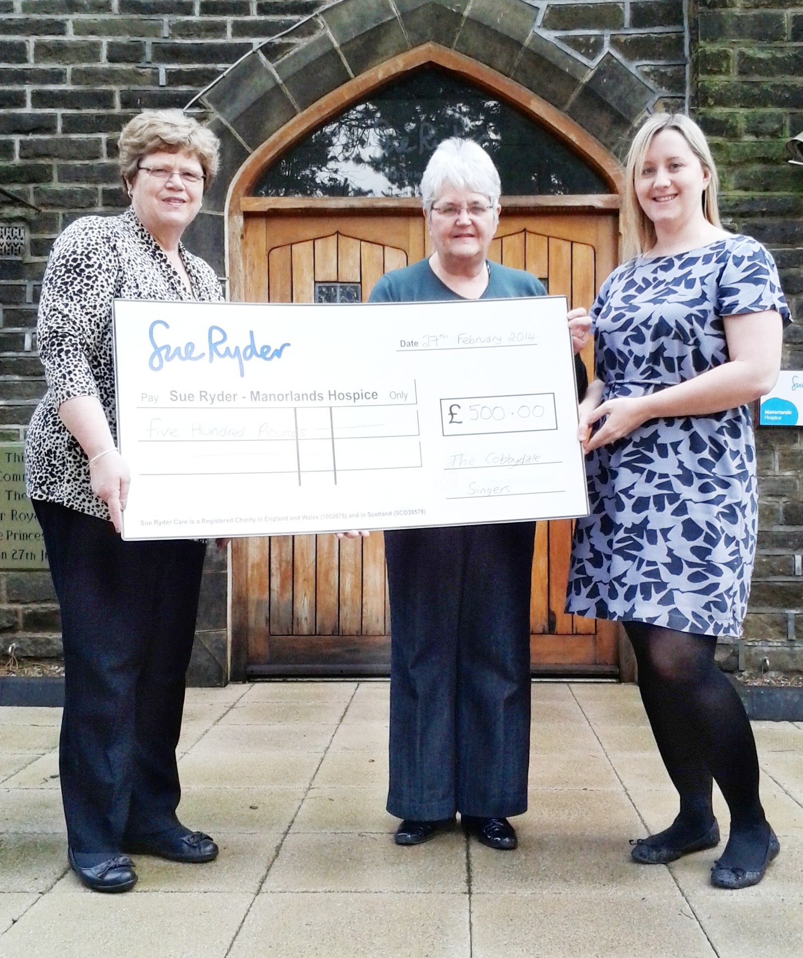 Karen Jones (right) is pictured receiving the cheque from Elaine Isherwood and Christine Barrett.