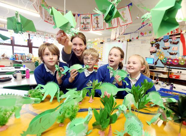 Craven Herald: ROAR: Settle Primary School hold a dinosaur workshop. Pictured are Alex Hartley, Aiden Howard, Estelle Mortimer, Milly Wild and Bella Horsfall