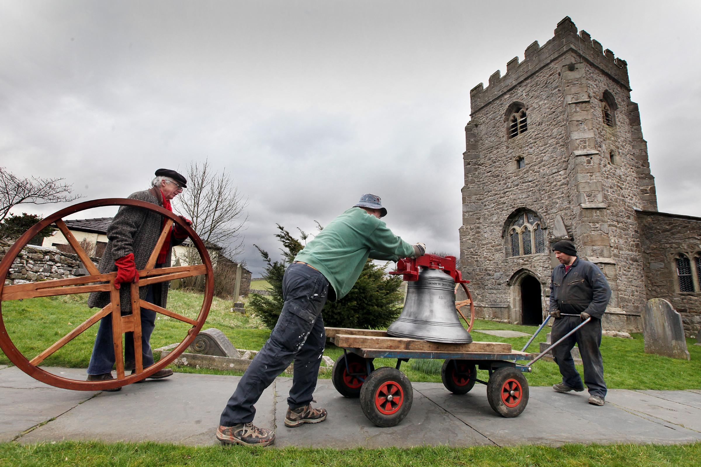 NEW ARRIVALS: parishioners at St Oswald's Church take delivery of the two new bells which will add to the four bells already in place