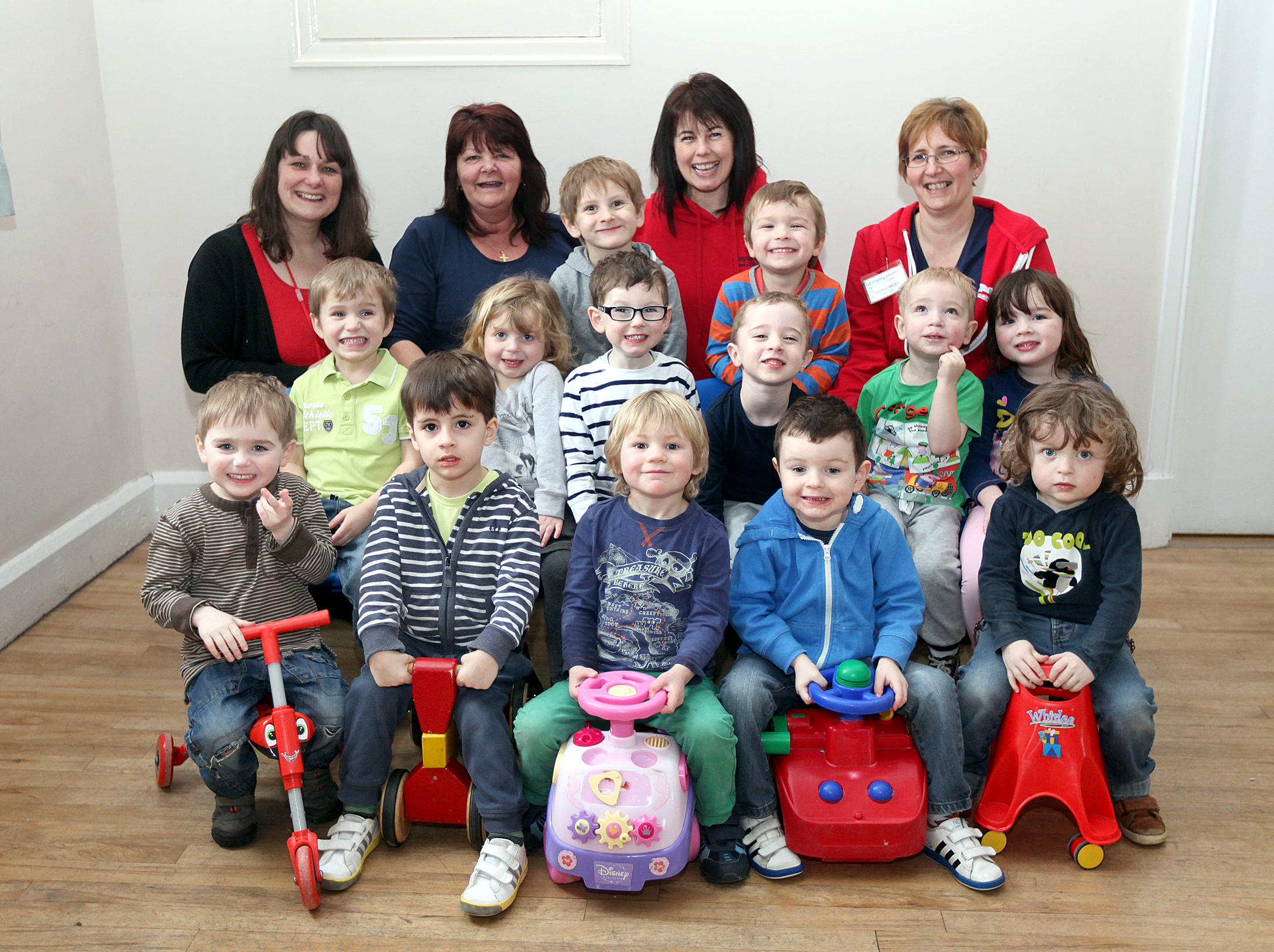 GOOD BEHAVIOUR NOTED: Staff and children at the Stepping Stones Nursery based at Cononley Village  Hall celebrate after being given a good Ofsted report