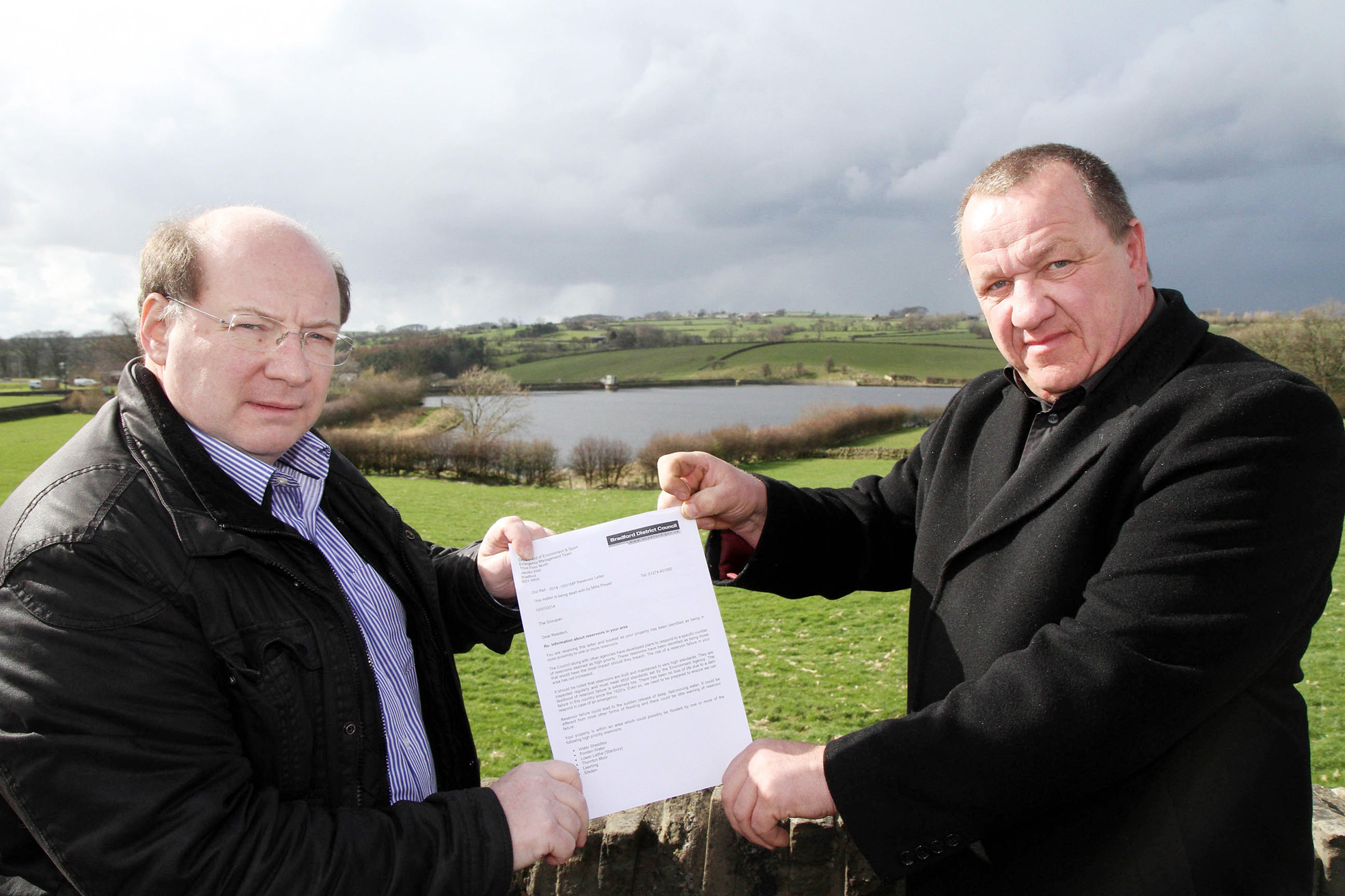 FLOOD RISK: Bradford councillor Adrian Naylor, left, and Silsden mayor Councillor Chris Atkinson, with the letter warning of the risk of flooding in the event of a reservoir dam collapse