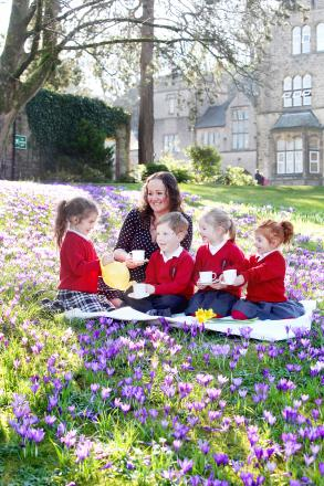Anyone for tea: Giggleswick Junior School pupils hold a fundraising Mothers' Day Tea Party. Mum Catherine Rudsdale is with Darcy Ogden, William Rudsdale, Sian Peek and Rubyann Mitchell.