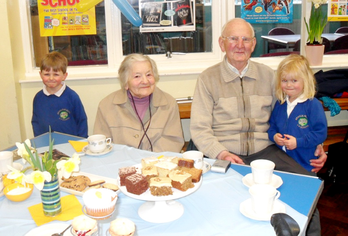 YOUNGEST AND OLDEST: Former pupils Malcolm Mattocks and Margaret Lancaster with James Bergin and Holly Hampshire