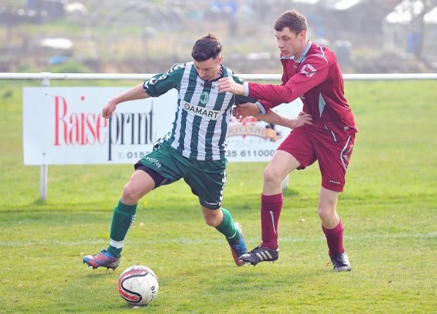 Steeton's Andy Holden is challenged by Littletown's Robin Knight.