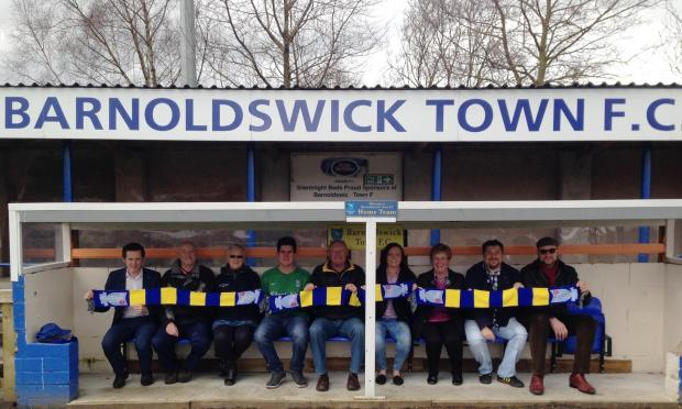 Craven Herald: Lyle Davy with Barnoldswick Town's officials and backers