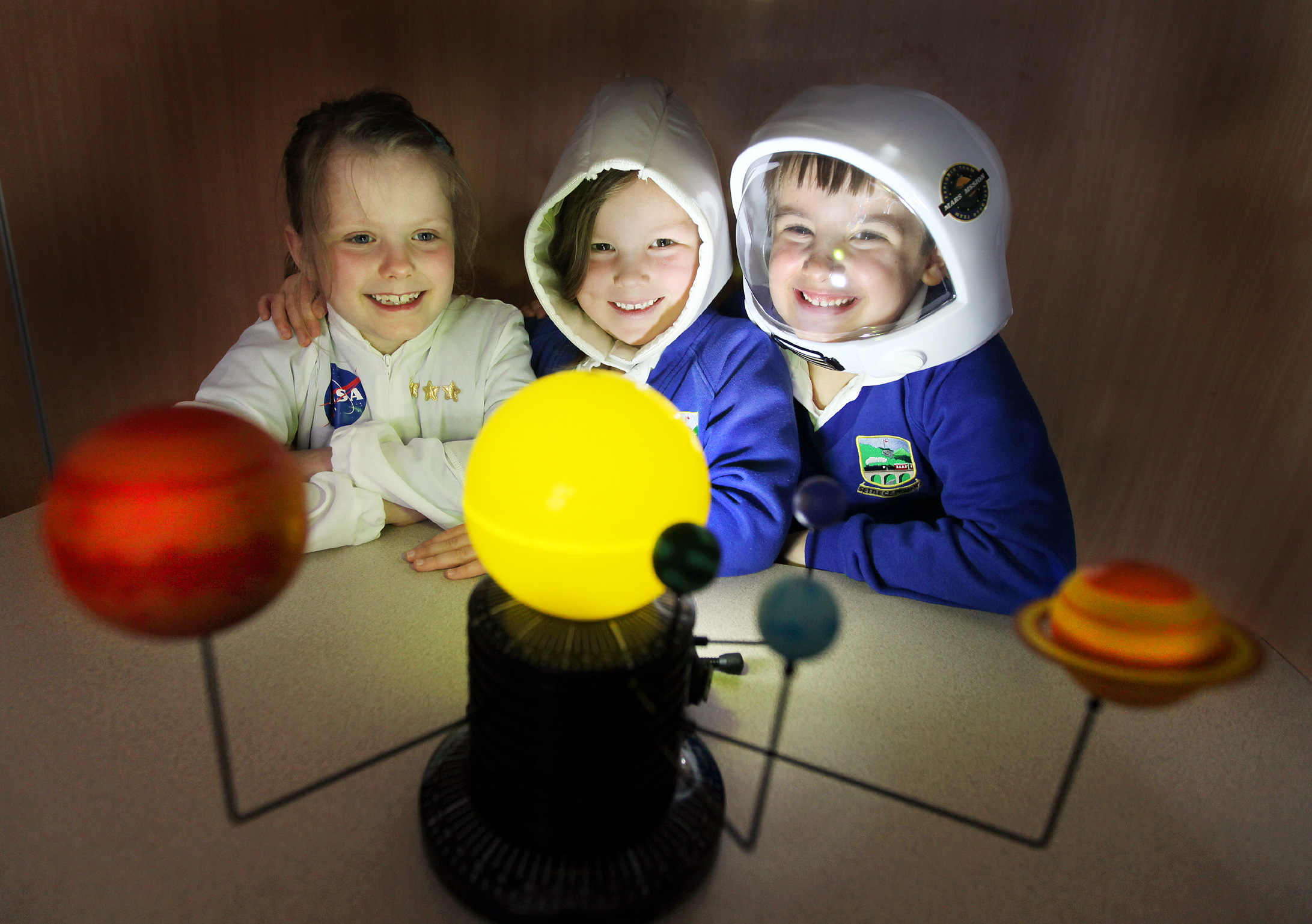 WOULD-BE ASTRONAUTS: Holly Brown, Isla Paton and Antonio Caggiano with the sun and surrounding planets