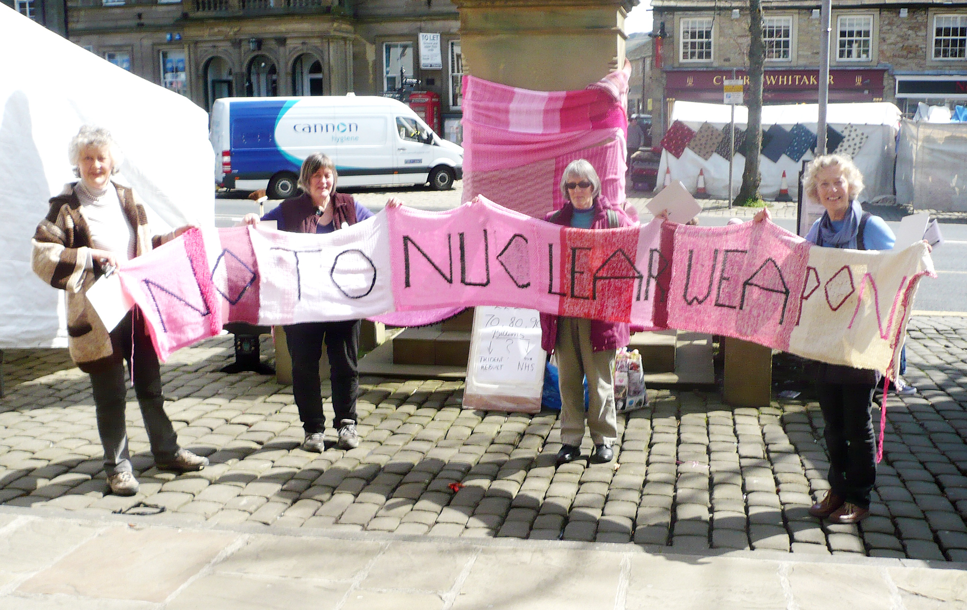 MATERIAL MESSAGE: Campaigners by the statue of Sir Matthew Wilson in Skipton's High Street