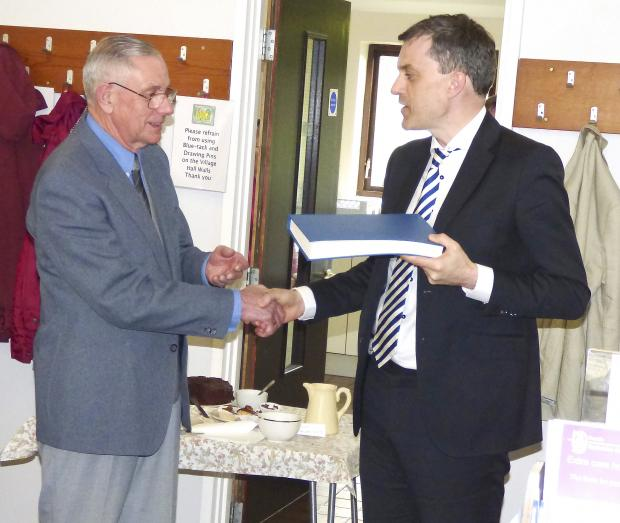 GOOD BOOK: Skipton MP Julian Smith, right, presents the gospel to Bryan Hume