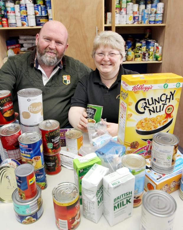 Craven Herald: FOOD FOR THOUGHT: Minister in training Michael Dewhirst and   co-ordinator Ella Smith celebrate Skipton Food Bank, based at Skipton Baptist Church, gaining £19,000 over the next two years