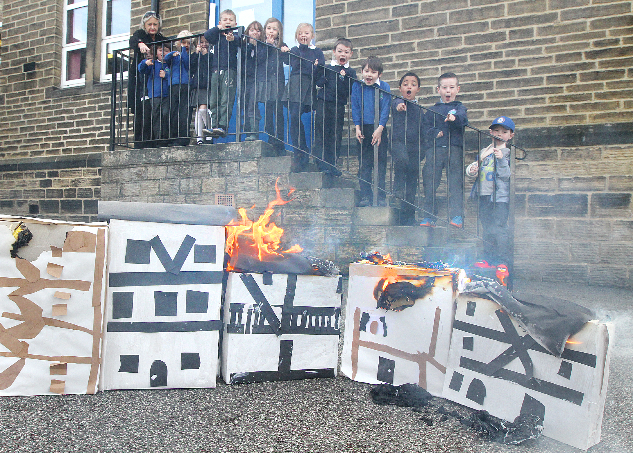 WHAT THE BLAZES: Pupils at Aire View Primary School in  Silsden, who built models and set fire to them  to re-create the Great Fire of London