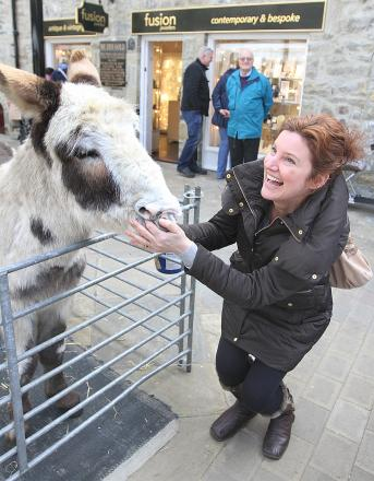 ANIMAL ANTICS: Samantha Hartley shares  a joke with Doodles the donkey at Skipton's Craven Court
