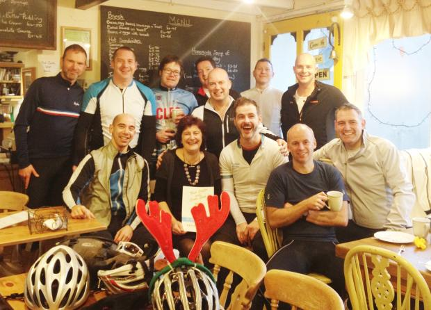 WHEELY GOOD: Zarina Belk, from Kettlewell's Zarina's Tearooms, with members of the  Wharfedale Wheelers
