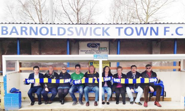 Craven Herald: WINNING TEAM: Barnoldswick Town goalkeeper Lyle Davy with new board members and investors