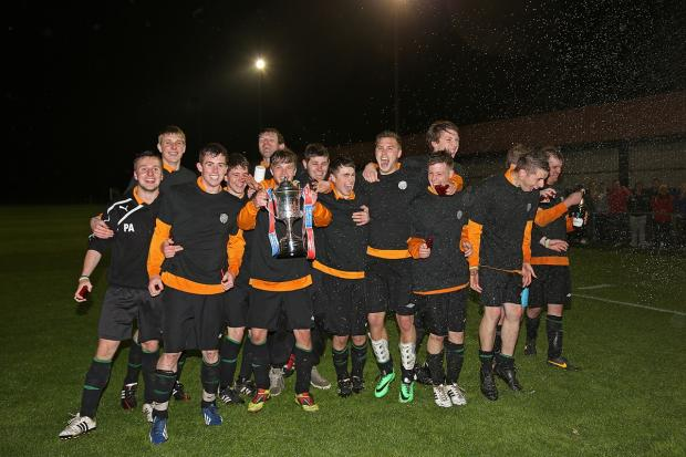 Craven Herald: Settle United spray the bubbly as they celebrate winning the West Riding County FA Challenge Trophy. Picture: Alex Daniel Photography