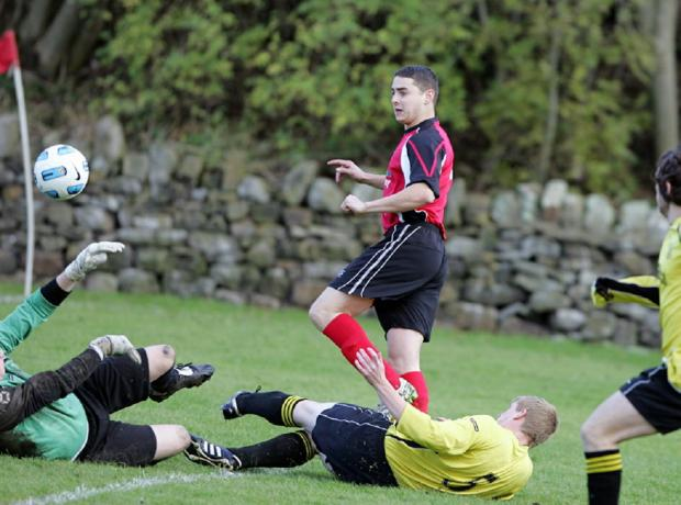 Lee Thompson levelled with a penalty for Cononley Sports in their Morrison Cup semi-final against Grassington United