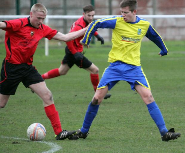 Craven Herald: Matthew Cavanagh, right, headed the ball against a post in a determined Barnoldswick Town display