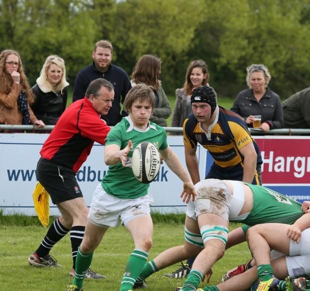 Craven Herald: Wharfedale's Philip Woodhead puts boot to ball at Worthing. Picture: Warwick Baker