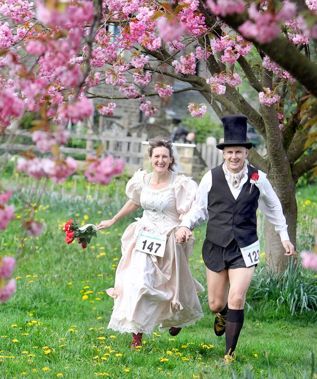 Craven Herald: RUN FOR YOUR WIFE: Stephanie French is in the lead as she and Andrew Kitts prepare for their wedding on Saturday – and the fun fell race which will take place before the ceremony in Addingham