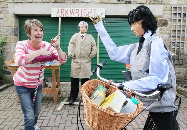 Craven Herald: DON'T YOU SCARE THE CUSTOMERS: Cononley Scarecrow Festival organiser Eileen Boothman viewing the Arkwright shop scarecrows from the classic comedy series Open All Hours.