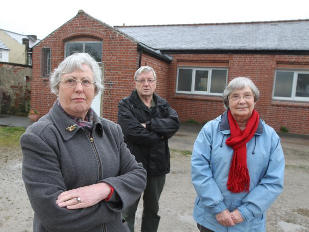 BOMBSHELL: Members of the congregation at St Joseph's Church , Cross Hills, speak out after the announcement that the church will close on Sunday, June 1. Mary Askew, Gerry and Joan Griffin are pictured outside St Joseph's