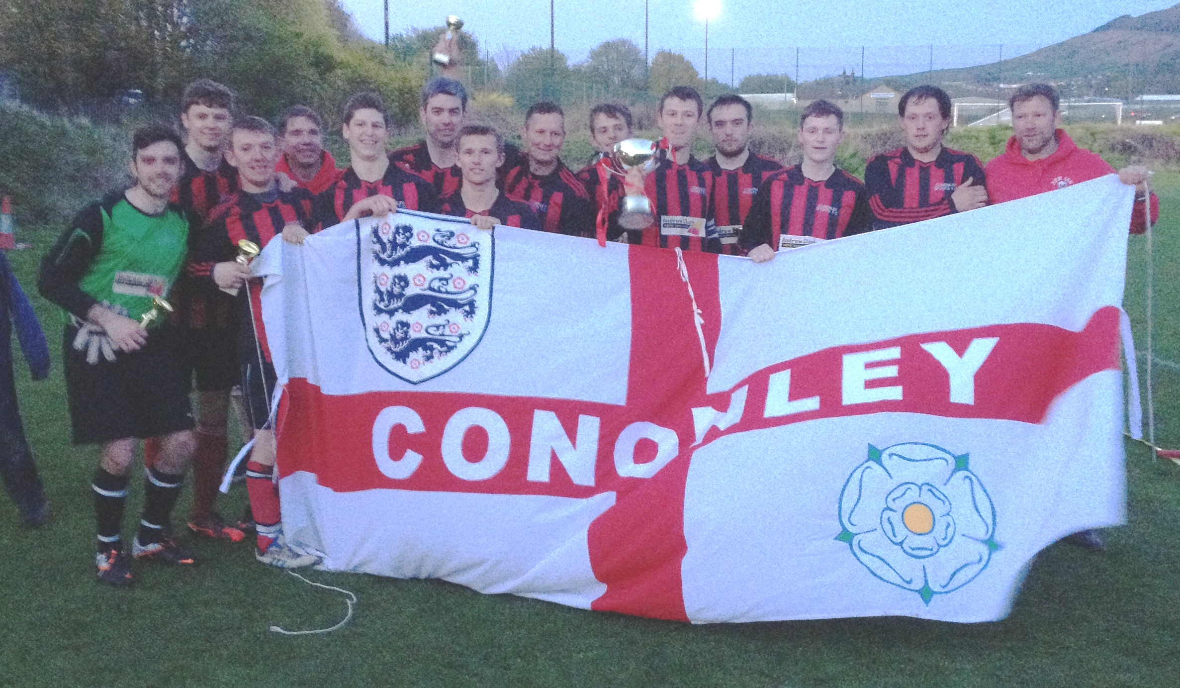 Flying the flag: Cononley Sports celebrate their Craven FA Morrison Cup final success at Sandylands